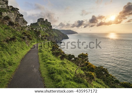 Beautiful sunset landscape image of Valley of The Rocks in Devon England - stock photo