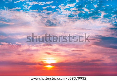 Beautiful sunset, light majestic clouds in the sky - stock photo