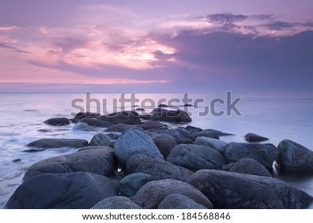 Beautiful sunset, lugnet, Sweden, rainclouds on the horizon - stock photo