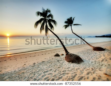Beautiful sunset on a empty beach in Thailand - stock photo