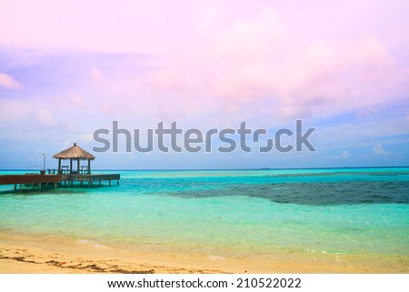 Beautiful sunset on a tropical island in Maldives - stock photo