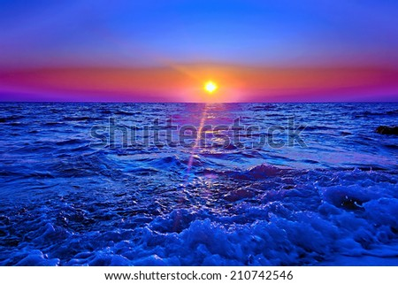 beautiful sunset on by sea background natural - stock photo