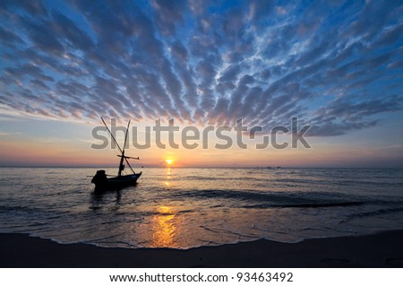 Beautiful sunset on lives of fishermen. - stock photo