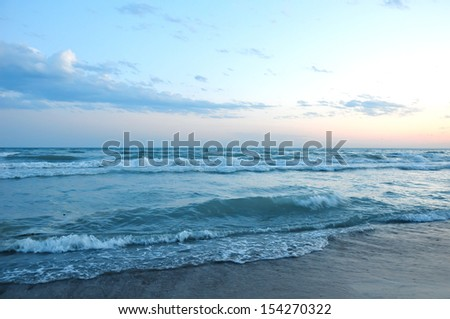 beautiful sunset on the beach - stock photo