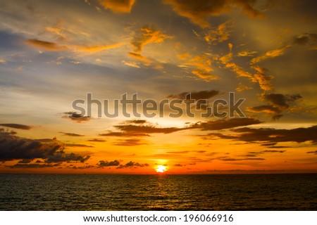 Beautiful sunset on the beach in island Koh Phangan, Thailand. - stock photo