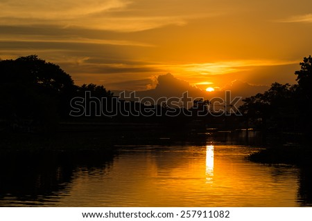beautiful sunset on the river - stock photo