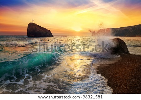 beautiful sunset on the sea with a wave - stock photo