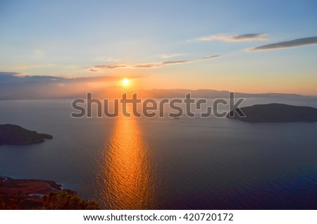 beautiful sunset on the shore of the picturesque island of Crete, Greece. - stock photo
