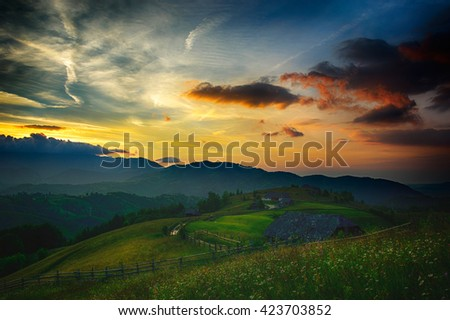 Beautiful sunset on wild mountain hills on Carpathian mountain. Low key, dark background, spot lighting, and rich Old Masters
