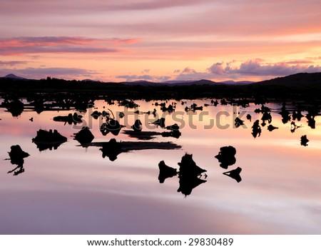 Beautiful sunset over a calm lake. - stock photo