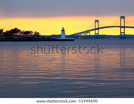 Beautiful sunset over Claiborne Pell Bridge and lighthouse in Newport, Rhode Island - stock photo