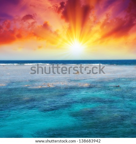 Beautiful sunset over Coral Reef, Queensland. - stock photo
