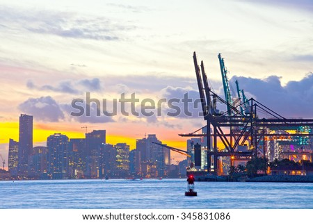 Beautiful sunset over  Downtown and the Port of Miami Florida, beautiful colorful sunset  - stock photo