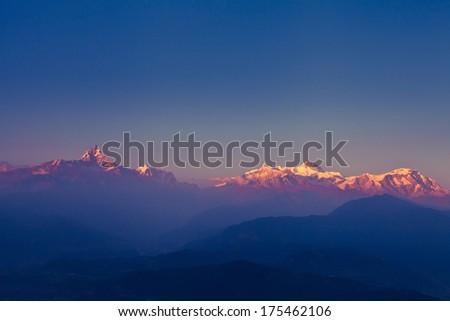 beautiful sunset over Himalaya mountains - stock photo