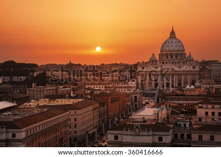 Beautiful sunset over Rome, Italy; St. Peter's Basilica on background. - stock photo