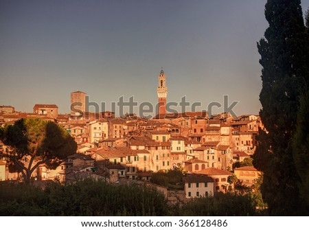 Beautiful sunset over Siena old city in Tuscany, Italy - stock photo