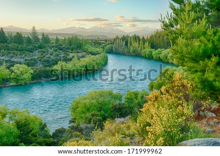 Beautiful sunset over the bend of the river Clutha, New Zealand - stock photo