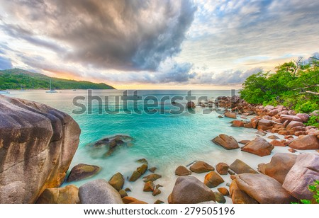 Beautiful sunset over the famous beach Anse Lazio, Praslin island, Seychelles.  - stock photo