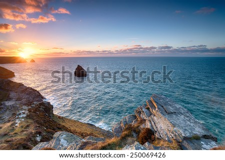 Beautiful sunset over the north Cornwall coast at Boscastle - stock photo