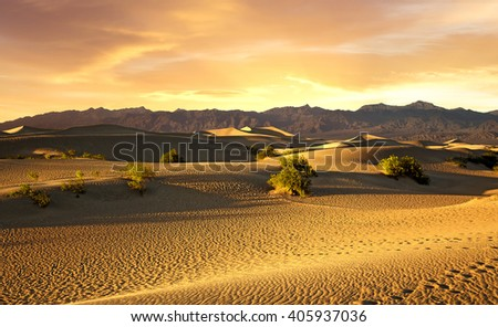 beautiful sunset over the sand dunes in Death Valley - stock photo