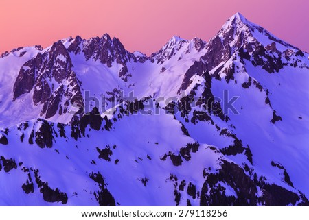 Beautiful sunset photo of rugged mountains and glaciers - stock photo