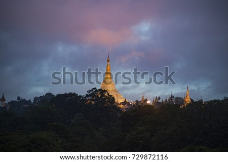 beautiful sunset sky and cloud over golden Shwedagon pagoda near Yangon city Myanmar