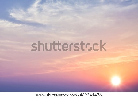 Beautiful sunset sky with bright sun and clouds