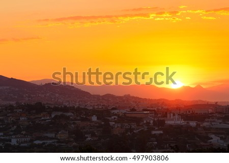 Beautiful Sunset Sunrise Over Mountain and city.