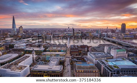 Beautiful sunset with dramatic sky over south London with famous skyscrapers, river Thames, museums and other landmarks - London, UK - stock photo