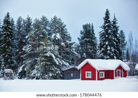 Beautiful super Finnish winter landscape with red wooden finnish house in winter covered with snow. - stock photo