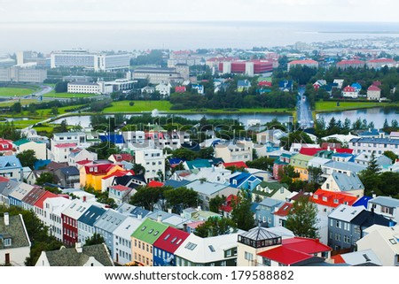 Beautiful super wide-angle aerial view of Reykjavik, Iceland with harbor and skyline  and scenery beyond the city, seen from the observation tower of Hallgrimskirkja Cathedral.  - stock photo