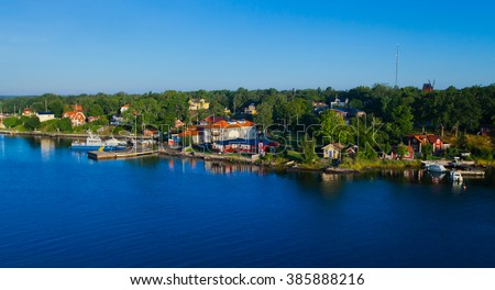 Beautiful super wide-angle panoramic aerial view of Stockholm archipelago, Sweden with harbor and skyline with scenery beyond the city, seen from the ferry, sunny summer day with blue sky - stock photo