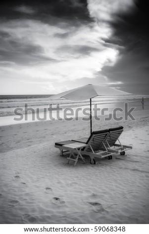 Beautiful surfing sand beach - black and white - stock photo