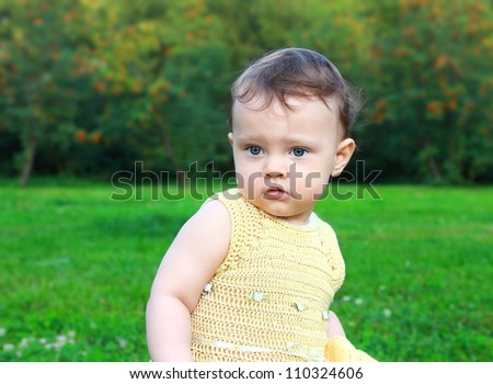 Beautiful surprised baby girl looking on nature green background  Fun closeup portrait - stock photo