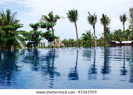 beautiful swimming pool at an Asian resort - stock photo