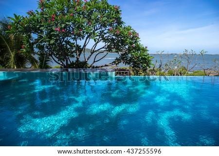 Beautiful swimming pool in hotel pool resort. - stock photo