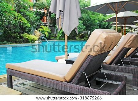 beautiful swimming pool in the tropics Resort - stock photo