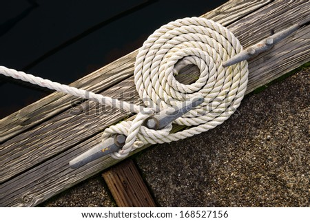 Beautiful Swirled Curled Rope Boat Bow Line Nautical Tie Down - stock photo