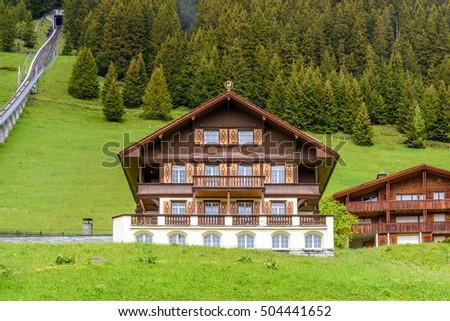Swiss Mountain House mountain swiss house wooden fotografie, snímky pro členy zdarma a