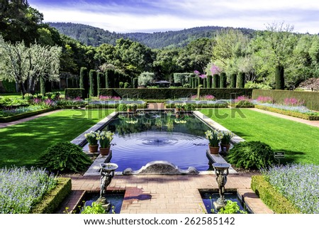 beautiful symmetrical english style garden with pool - stock photo