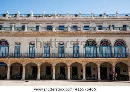 Beautiful symmetry of arches and balconies of Hotel Santa Isabel, Havana, Cuba - stock photo