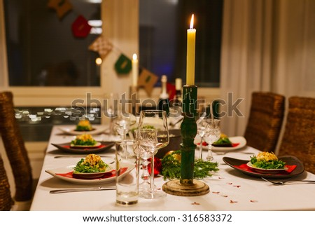 Beautiful table setting for Christmas party or New Year celebration at family home - stock photo