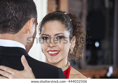 Beautiful Tango Dancer Performing Gentle Embrace Step With Man