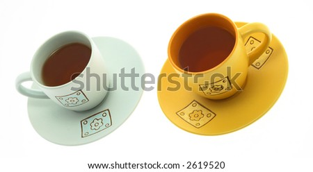 Beautiful tea cups on a white background - stock photo
