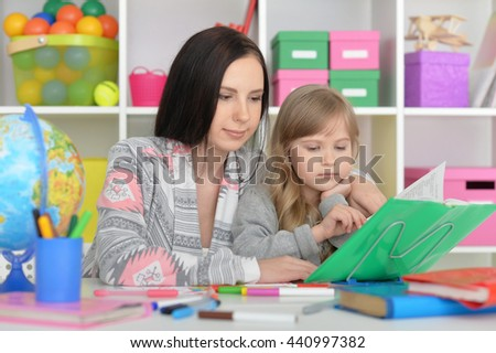 beautiful teacher and little girl