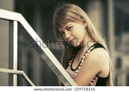 Beautiful teen girl at the school building  - stock photo