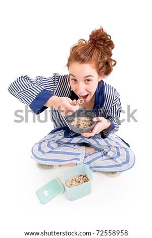 Beautiful teen girl eat brekfast on white background - stock photo