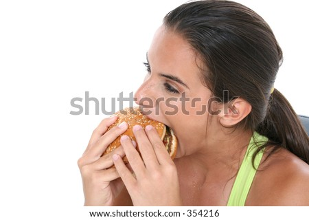 Beautiful Teen Girl Eating a Giant Cheeseburger after a workout.