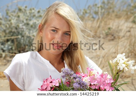 beautiful teen girl holding flowers - stock photo