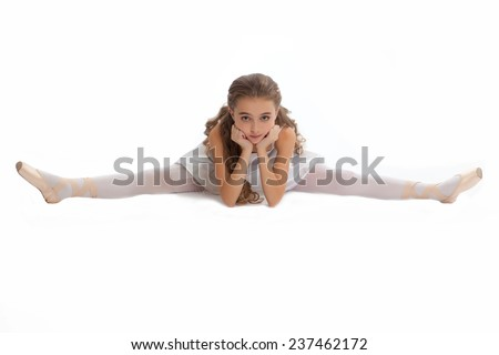 beautiful teen girl in white clothes  ballet pose with long hair isolated on white background - stock photo